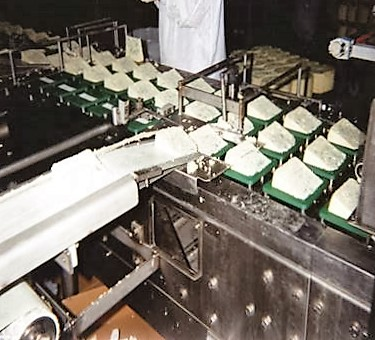 Automatic packaging system for cheese